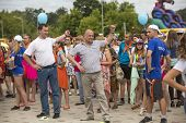 TIKHVIN, RUSSIA - JUL 5, 2014: Head of Tikhvin region Alex.Lazarevich (R) and head of administration