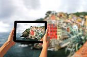 Girl Taking Pictures On A Tablet In Riomaggiore