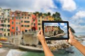Riomaggiore Woman Taking Pictures On A Tablet