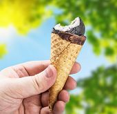 Hand Holding A Chocolate Ice Cream