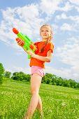 Nice kid girl with a water gun