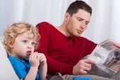 Child Sitting With Dad Reading Newspaper