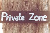 Private zone sign standing for private property restricted access