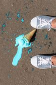 Ice cream fell on asphalt top view