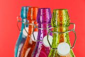 Colorful bottles on red background