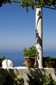 Постер, плакат: flowered balcony on the Aegean Sea