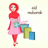 picture of eid mubarak  - Religious Muslim girl holding gift boxes and shopping bags for Muslim community festival Eid Mubarak celebrations - JPG