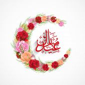 Arabic islamic calligraphy of text Eid Mubarak and crescent moon decorated with colorful roses on gr