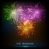 Shiny colorful fireworks on black background for muslim community festival Eid Mubarak celebrations.