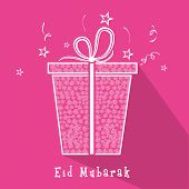Stylish gift box on stars decorated pink background for muslim community festival Eid Mubarak celebr