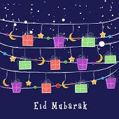 Eid Mubarak celebrations greeting card design with colourful gift boxes, moons and stars on blue bac