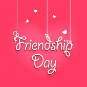 Beautiful greeting card design with stylish hanging text Friendship Day on pink background.