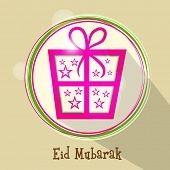 Shiny sticky with pink gift box decorated with stars for Muslim community festival Eid Mubarak celeb