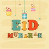Muslim community festival Eid Mubarak celebrations with colorful text and gift boxes on beige backgr