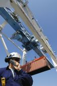port worker, crane and containers