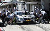 VOLOKOLAMSK, MOSKOW REGION - JULY 13, 2014: DTM (Deutsche Tourenwagen Masters) Moscow Raceway. Replacing Car Tires