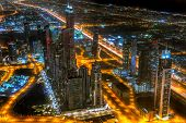 DUBAI, UAE -1 APRIL 2014: Panorama of city centre in Dubai at night, UAE. View from the 124 floor of