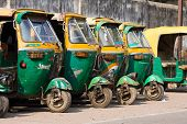 Auto Rickshaw Taxis On A Road In Agra, India.