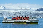 Jokusarlon, Iceland, July 7th 2014. - Tourists wearing life vests ride on amphibian vehicle named 'D