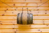 Gable Of Wooden Rural House And Barrel With Chains