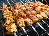 stock photo of kebab  - Traditional shish kebab prepared on skewers, on coals