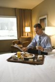 Businessman With Hotel Room Service