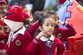KATHMANDU, NEPAL - DEC 22, 2013: Unknown pupils during dance lesson in primary school. Only only 25%