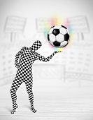 Funny man in full body suit holdig soccer ball
