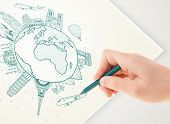 Hand drawing vacation trip around the globe with landmarks and major cities