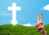 Happy finger smiley faces on hand with christian religion cross