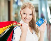 Woman With Bags And Credit Card