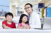 Friendly Doctor With Children 1