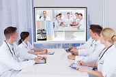Doctors Having Video Conference Meeting In Hospital