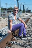 Attractive young guy on rails