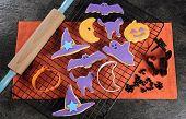 Happy Halloween Orange And Purple Sugar Cookies In Cat, Hat, Bat And Pumpkin Shapes With Baking Uten