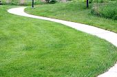 pic of curvy  - curvy cycling and running path on grass  - JPG