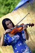 Woman With Violin Outdoors