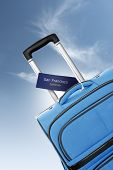 San Francisco, California. Blue Suitcase With Label