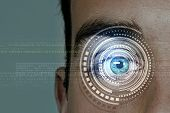 Close up of man eye with digital icons