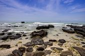 Tropical seascape - rocks , sea and blue sky