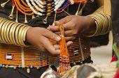 tribal woman making jewellery