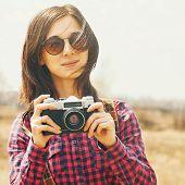 Traveler Woman Holding Vintage Photo Camera