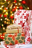 Gifts on chair in decorated Christmas living room  on wooden wall background