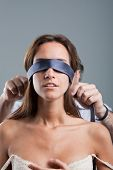 Sexy Woman Being Blindfolded By Man