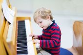 picture of little kids  - Two years old funny positive toddler child playing piano - JPG