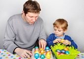 Little Boy And His Mother Being Happy About Selfmade Easter Eggs, Indoors