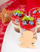 Christmas Dessert. Sweet Dessert Tiramisu With Strawberry, Fresh Blueberry And Mint Creme