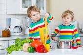 Two Little Kid Boys Cooking Pasta With Fresh Vegetables