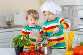 Two Cute Brothers Cooking Italian Meal With Spahetti