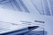 Invoice Documents And Pen On Table
